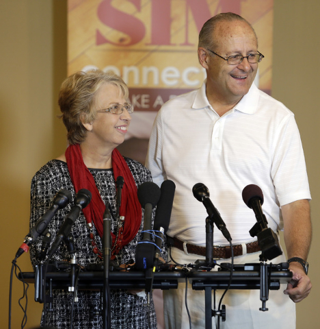 Nancy Writebol,  who spent weeks in isolation after contracting the deadly Ebola virus in Liberia, holds a news conference, Wednesday, Sept., 3, 2014 in Charlotte, N.C. with her husband, David. Th ...