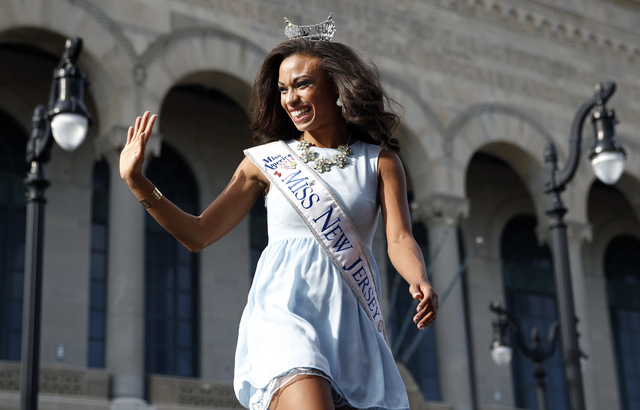 Miss New Jersey Cierra Kaler-Jones waves during Miss America Pageant arrival ceremonies Wednesday, Sept. 3, 2014, in Atlantic City, N.J. Miss America contestants from all 50 states, the District o ...