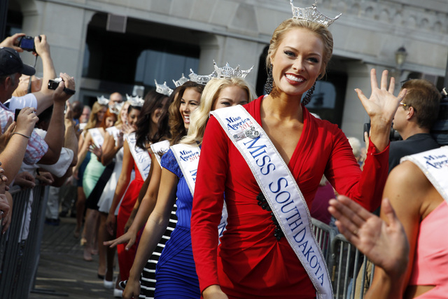Miss South Dakota Meridith Gould waves during Miss America Pageant arrival ceremonies Wednesday, Sept. 3, 2014, in Atlantic City, N.J. Miss America contestants from all 50 states, the District of  ...