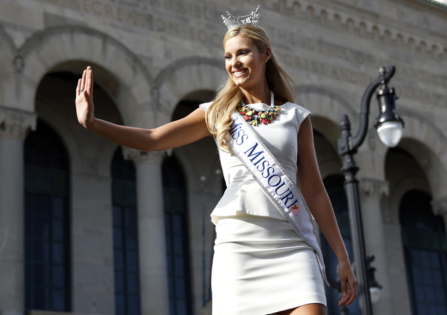 Miss Missouri Jessica Hartman waves during Miss America Pageant arrival ceremonies Wednesday, Sept. 3, 2014, in Atlantic City, N.J. Miss America contestants from all 50 states, the District of Col ...