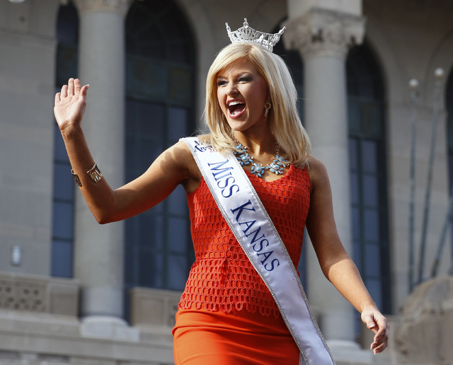 Miss Kansas Amanda Sasek waves during Miss America Pageant arrival ceremonies Wednesday, Sept. 3, 2014, in Atlantic City, N.J. Miss America contestants from all 50 states, the District of Columbia ...