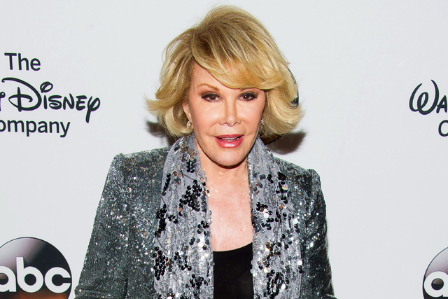 In this May 14, 2014 file photo, TV personality Joan Rivers attends A Celebration of Barbara Walters in New York (Photo by Charles Sykes/Invision/AP, File)