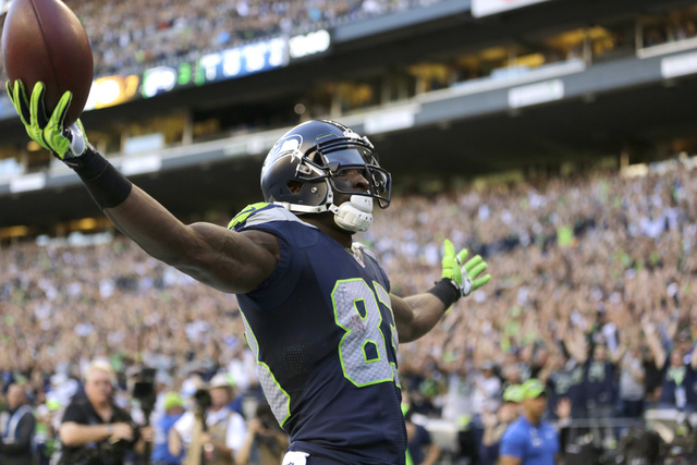 Seattle Seahawks wide receiver Ricardo Lockette celebrates after his touchdown against the Green Bay Packers in the first half of an NFL football game, Thursday, Sept. 4, 2014, in Seattle. (AP Pho ...