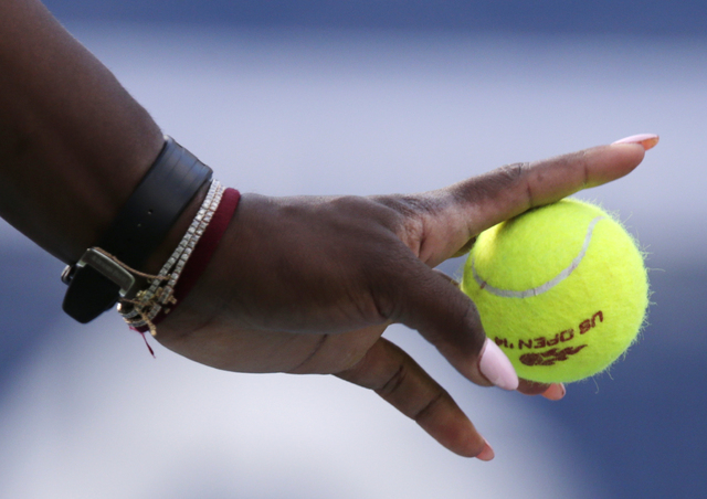 Serena Williams prepares to serve against Caroline Wozniacki, of Denmark, during the championship match of the 2014 U.S. Open tennis tournament, Sunday, Sept. 7, 2014, in New York. (AP Photo/Charl ...