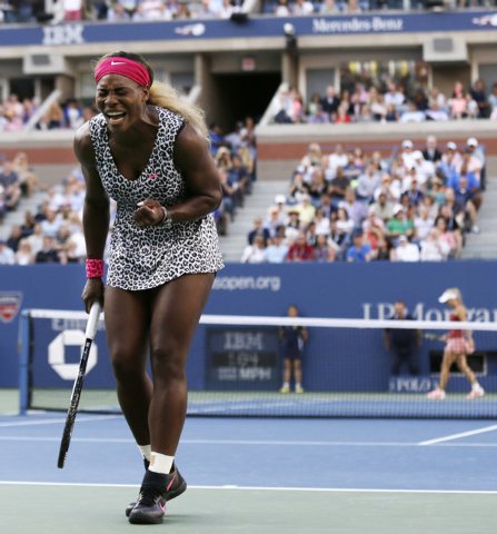 Serena Williams, reacts after a shot against Caroline Wozniacki, of Denmark, during the championship match of the 2014 U.S. Open tennis tournament, Sunday, Sept. 7, 2014, in New York. (AP Photo/Ch ...