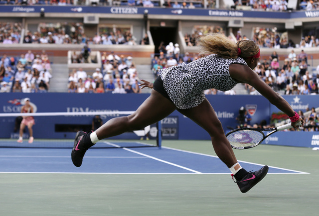 Serena Williams, returns a shot against Caroline Wozniacki, of Denmark, during the championship match of the 2014 U.S. Open tennis tournament, Sunday, Sept. 7, 2014, in New York. (AP Photo/Charles ...