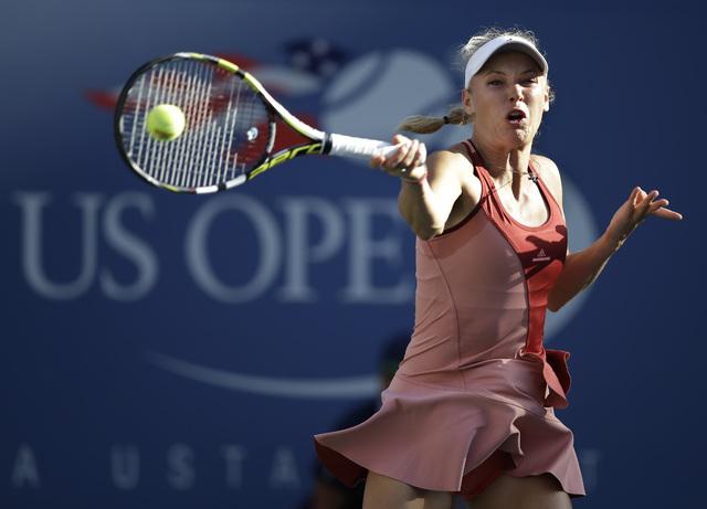 Caroline Wozniacki, of Denmark, returns a shot against Serena Williams during the championship match of the 2014 U.S. Open tennis tournament, Sunday, Sept. 7, 2014, in New York. (AP Photo/Darron C ...