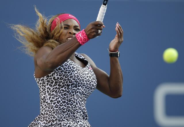 Serena Williams, returns a shot against Caroline Wozniacki, of Denmark, during the championship match of the 2014 U.S. Open tennis tournament, Sunday, Sept. 7, 2014, in New York. (AP Photo/Darron  ...