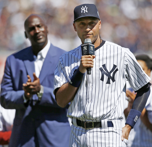 Michael Jordan, left applauds as New York Yankees' Derek Jeter (2) speaks in a pregame ceremony honoring Jeter, who is retiring at the end of the season, on Derek Jeter Day at Yankee Stadium in Ne ...