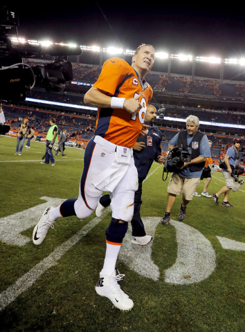 Denver Broncos quarterback Peyton Manning (18) leaves the field after an NFL football game against the Indianapolis Colts, Sunday, Sept. 7, 2014, in Denver. The Broncos won 31-24. (AP Photo/Jack D ...