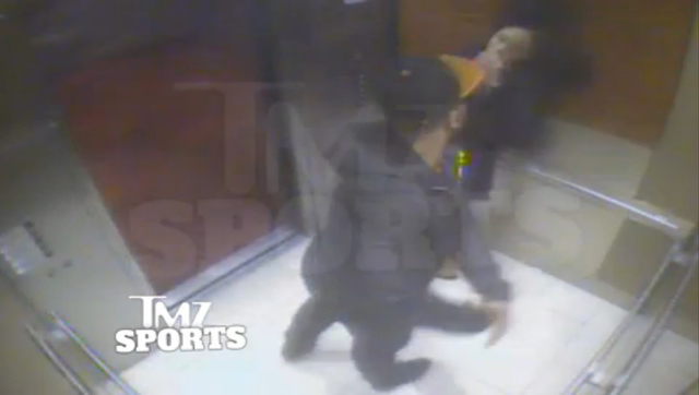 In this still image taken from a hotel security video released by TMZ Sports, Baltimore Ravens running back Ray Rice punches his fiancee, Janay Palmer, in an elevator at the Revel casino in Atlant ...