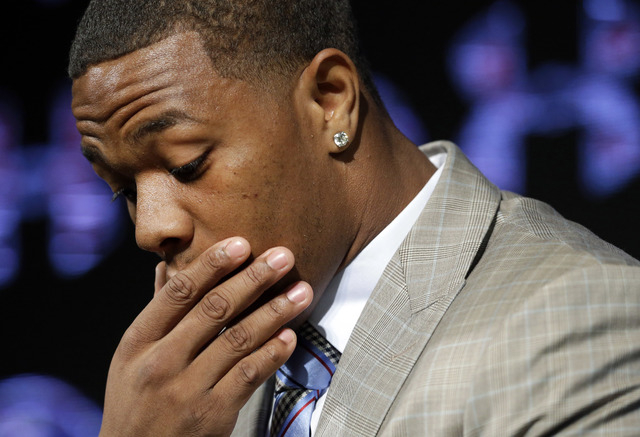 In this May 23, 2014, file photo,  former Baltimore Ravens running back Ray Rice pauses as he speaks during a news conference at the team's practice facility in Owings Mills, Md. (AP Photo/Patrick ...