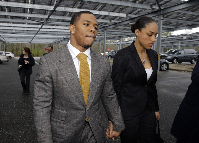 In this May 1, 2014, file photo, Baltimore Ravens football player  Ray Rice holds hands with his wife, Janay Palmer, as they arrive at Atlantic County Criminal Courthouse in Mays Landing, N.J. Ban ...