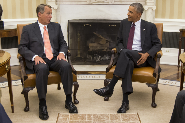 President Barack Obama talks with House Speaker John Boehner of Ohio in the Oval Office of the White House in Washington, Tuesday, Sept. 9, 2014. Boehner said on Thursday Republican lawmakers have ...
