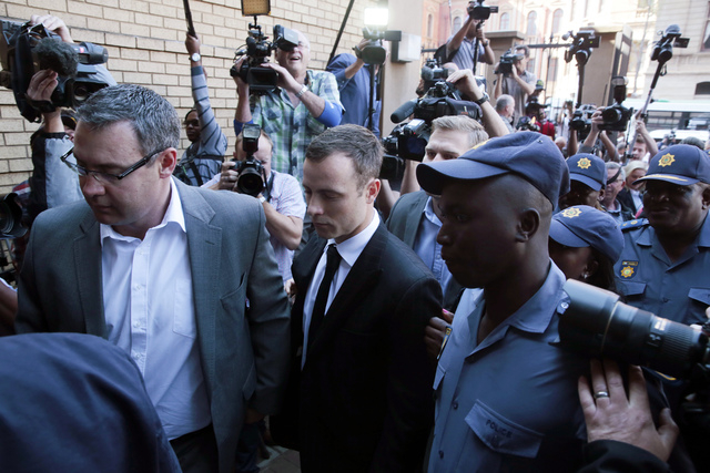 Oscar Pistorius arrives at a court in Pretoria, South Africa, Thursday, Aug. 11, 2014. Judge Thokozile Masipa is to deliver a judgment. Pistorius could face 25 years to life in prison if convicted ...