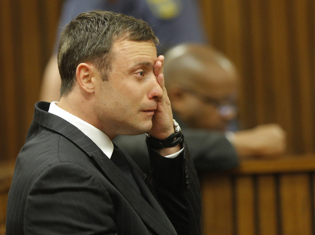 Oscar Pistorius cries in the dock in Pretoria, South Africa, Thursday, Sept. 11, 2014 as Judge Thokozile Masipa reads notes as she delivers her verdict in Pistorius' murder trial. The verdict is e ...