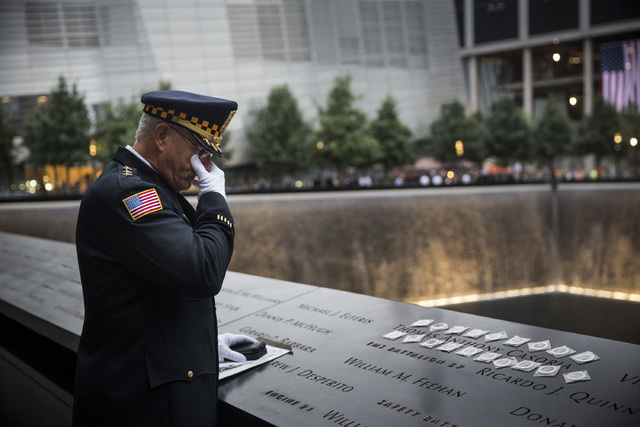 Sam Pulia, mayor of Westchester, Illinois, and a former police officer of the same town, mourns over the name of his cousin, New York firefighter Thomas Anthony Casoria, who was killed in the Sout ...