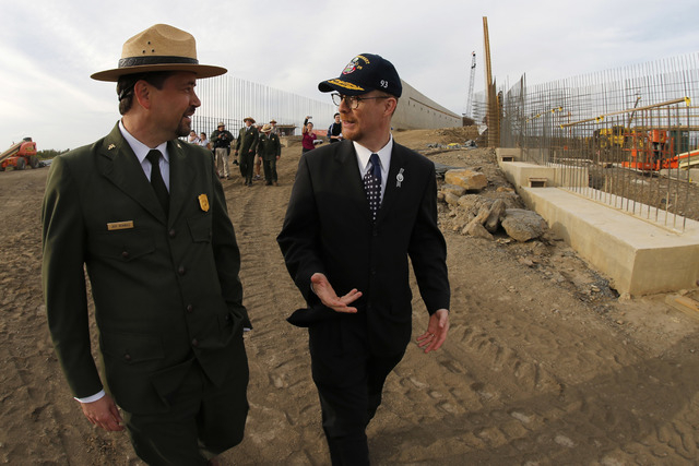 Jeff Reinbold of the National Park Service, left, walks with Gordon Felt, who lost his brother Edward Felt on Flight 93, during a tour of the Flight 93 Visitors Center Complex that is under constr ...