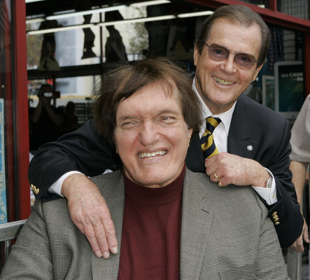 """FILE - In this Oct. 11, 2007 file photo, actor Roger Moore, right, who played the part of James Bond 007 in seven films, poses with actor Richard Kiel who played the role of Jaws in """"The Spy  ..."""
