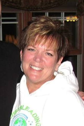 This undated file photo provided by Randy Budd shows his wife, Sharon Budd. Budd, a northeast Ohio woman who was critically injured when a rock was dropped on her family's car from a Pennsylvania  ...