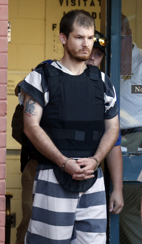 Timothy Ray Jones Jr., is escorted by lawmen out of the Smith County Jail to a vehicle for transport to Lexington County, S.C., Thursday, Sept. 11, 2014 in Raleigh, Miss. Jones is expected to be c ...