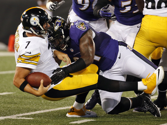 Pittsburgh Steelers quarterback Ben Roethlisberger (7) is sacked by Baltimore Ravens outside linebacker Courtney Upshaw during the first half of an NFL football game Thursday, Sept. 11, 2014, in B ...