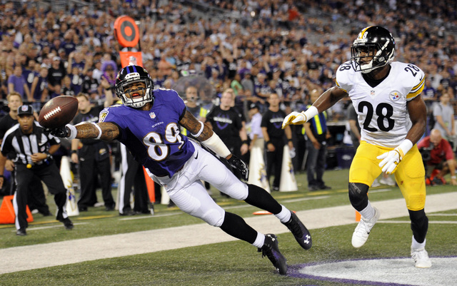 Baltimore Ravens wide receiver Steve Smith (89) gets a hand on ...
