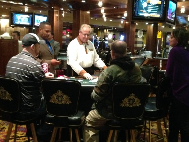 A dealer deals the final hand of blackjack at Trump Plaza Hotel and Casino in Atlantic City, N.J., seconds before the casino closed on Tuesday, Sept. 16, 2014. Trump Plaza is the fourth Atlantic C ...