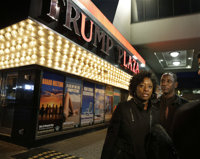 Ruth Hardrick, a dealer who worked at Trump Plaza Hotel & Casino for 26 years, stands with friend, Anthony Powell, on The Boardwalk, as she answers a question after the casino closed early Tuesday ...