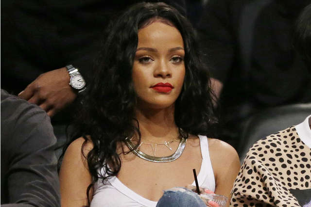 This April 25, 2014 file photo shows singer Rihanna watching Game 3 of an NBA basketball first-round playoff series between the Brooklyn Nets and the Toronto Raptors in New York. CBS said Tuesday, ...