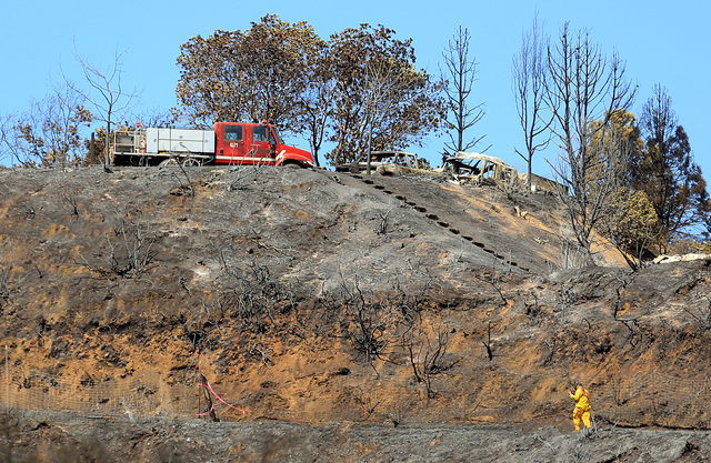 Damage lines the Black Bart Trail in Redwood Valley, California, Monday, Sept. 15, 2014. The wildfire is one of dozens to recently rip through the state. (AP Photo/The Press Democrat, Kent Porter)