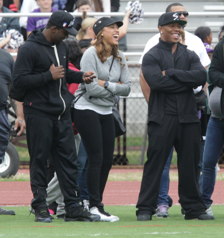 Ray Rice, right, and his wife Janay Rice attend the Ramapo versus New Rochelle high school football game at New Rochelle High School Saturday, Sept. 13, 2014, in New Rochelle, N.Y. The star runnin ...