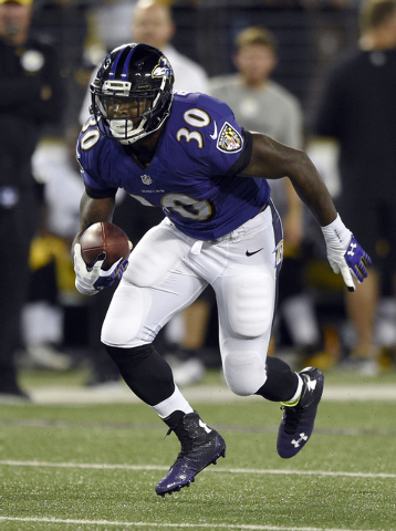 In this photo taken on Thursday, Sept. 11, 2014, Baltimore Ravens running back Bernard Pierce runs with the ball during the first half of an NFL football game against the Pittsburgh Steelers in Ba ...