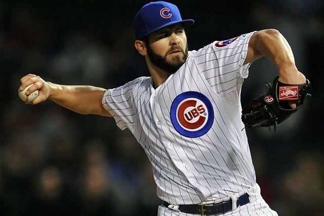 Chicago Cubs starter Jake Arrieta delivers a pitch during the first inning of a baseball game against the Cincinnati Reds in Chicago, Tuesday, Sept. 16, 2014. (AP Photo/Paul Beaty)