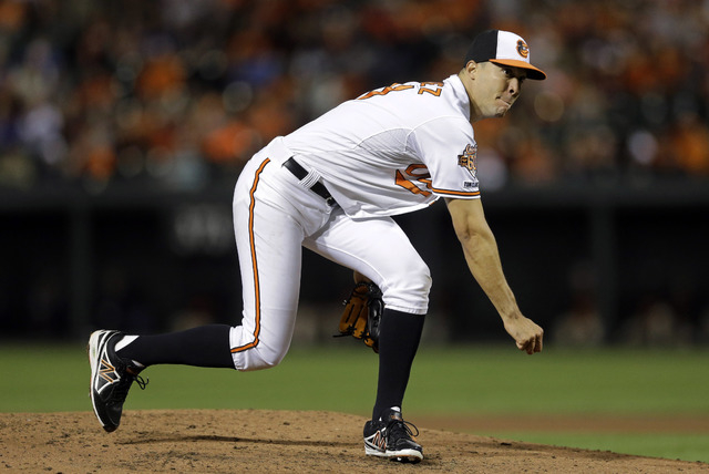 Baltimore Orioles starting pitcher Ubaldo Jimenez follows through on a pitch to the Toronto Blue Jays in the fourth inning of a baseball game, Tuesday, Sept. 16, 2014, in Baltimore. (AP Photo/Patr ...