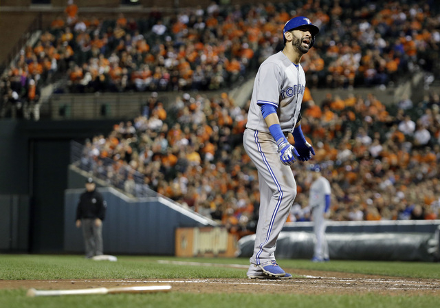 Toronto Blue Jays' Jose Bautista reacts after striking out looking in the fifth inning of a baseball game against the Baltimore Orioles, Tuesday, Sept. 16, 2014, in Baltimore. (AP Photo/Patrick Se ...