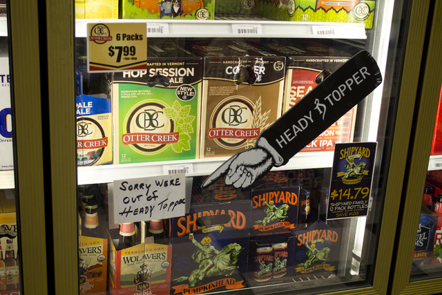 In this Sept. 11, 2014 photo, beer is displayed at Beverage Baron in Barre, Vt. Heady Topper, the intensely hoppy American double IPA by The Alchemist Brewery in Waterbury, Vt.,  is wildly popular ...