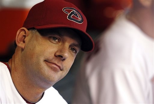 In this May 21, 2010, file photo, Arizona Diamondbacks manager A.J. Hinch listens to players prior to the first inning of an interleague baseball game against the Toronto Blue Jays in Phoenix. The ...