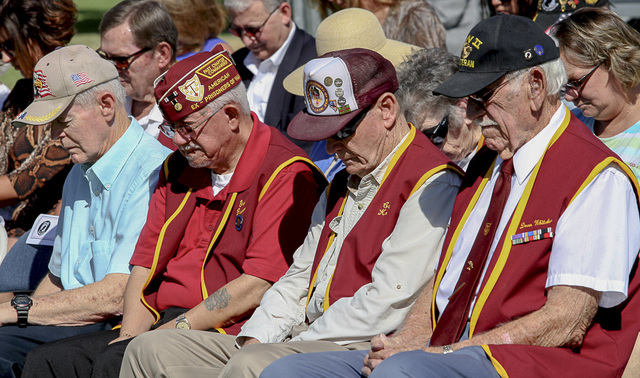 Ex-Prisoners of War Steve Long, from left, Gene Ramos, Carroll Knutson and Dean Whitaker pray during a ceremony Friday, Sept 19, 2014, at Nellis Air Force Base to remember prisoners of war and tho ...
