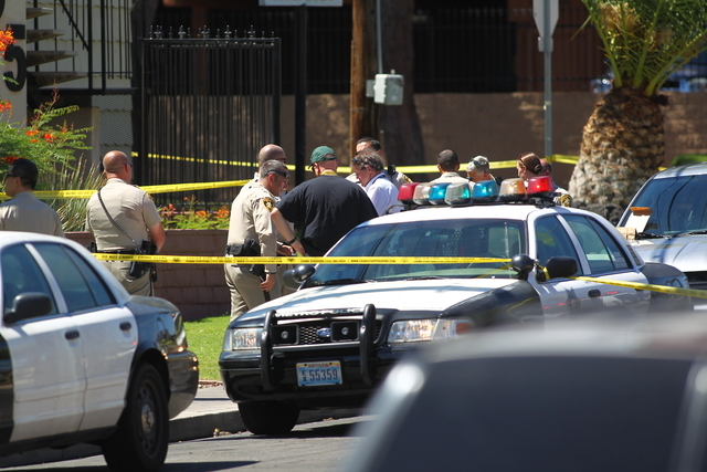 Police investigate the seen of a shooting at Maryland Parkway and Desert Inn Road on Sept. 3, 2014. (Chase Stevens/Las Vegas Review-Journal)