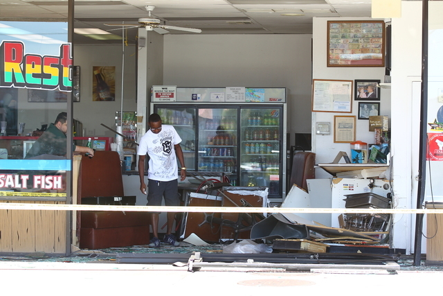 No one was injured when a small SUV smashed into a restaurant on West Flamingo Road Wednesday, Sept. 24, 2014, Las Vegas Police said. (Chase Stevens/Las Vegas Review-Journal)