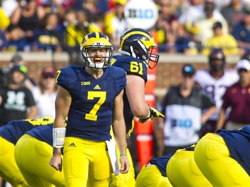 Michigan quarterback Shane Morris (7) shouts at his offensive line in the second quarter of an NCAA college football game against Minnesota in Ann Arbor, Mich., Saturday, Sept. 27, 2014. (AP Photo ...
