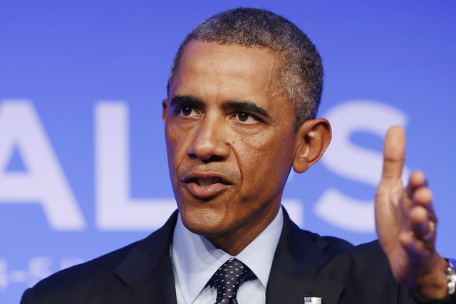 U.S. President Barack Obama answers a question at a news conference at the conclusion of the NATO Summit at the Celtic Manor Resort in Newport, Wales September 5, 2014. (REUTERS/Larry Downing)