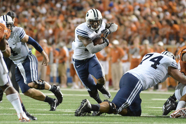 Sep 6, 2014; Austin, TX, USA; Brigham Young Cougars running back Jamaal Williams (21) carries the ball against the Texas Longhorns during the second half at Darrell K Royal-Texas Memorial Stadium. ...