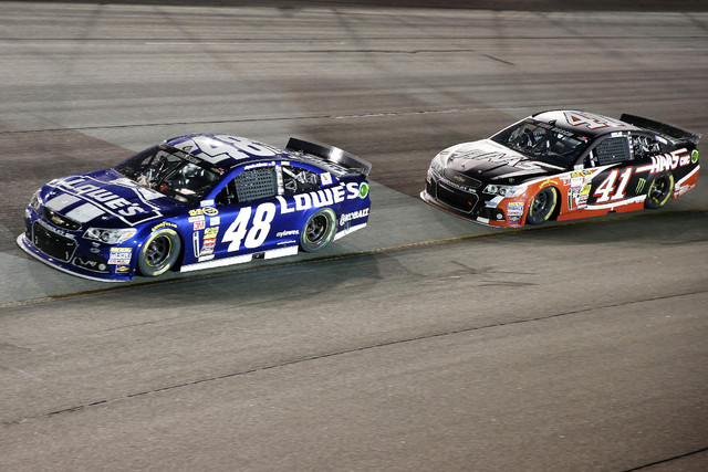 Sprint Cup Series driver Jimmie Johnson (48) races driver Kurt Busch (41) during the Federated Auto Parts 400 at Richmond International Raceway on Sept. 6, 2014. (Amber Searls/USA TODAY Sports)