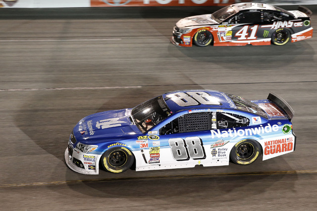 Sprint Cup Series driver Dale Earnhardt Jr. (88) races driver Kurt Busch (41) during the Federated Auto Parts 400 at Richmond International Raceway on Sept. 6, 2014. (Amber Searls/USA TODAY Sports)