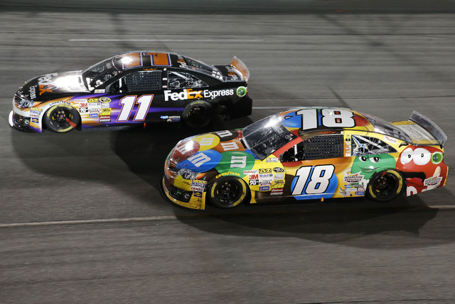 Sprint Cup Series driver Kyle Busch (18) races driver Denny Hamlin (11) during the Federated Auto Parts 400 at Richmond International Raceway on Sept. 6, 2014. (Amber Searls/USA TODAY Sports)