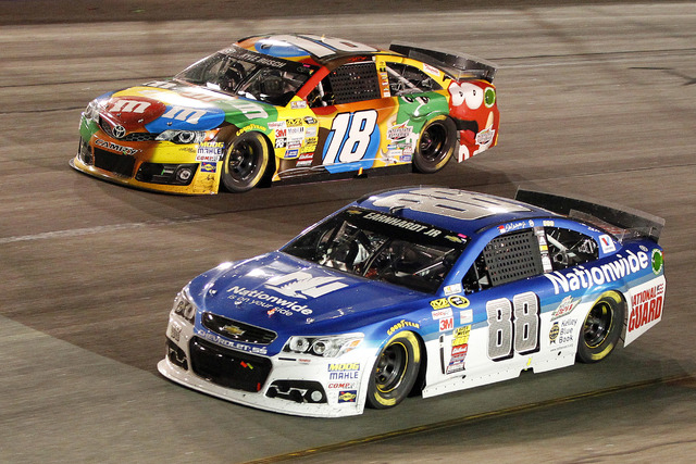 Sprint Cup Series driver Dale Earnhardt Jr. (88) races driver Kyle Busch (18) during the Federated Auto Parts 400 at Richmond International Raceway on Sept. 6, 2014. (Amber Searls/USA TODAY Sports)