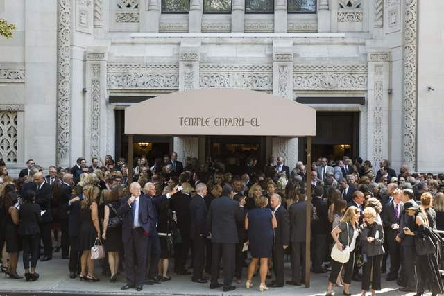 Mourners depart the funeral of comedian Joan Rivers at Temple Emanu-El in New York September 7, 2014. REUTERS/Lucas Jackson (UNITED STATES - Tags: ENTERTAINMENT OBITUARY)
