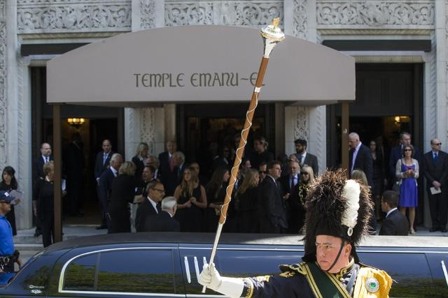 A member of a bagpipe ensemble gestures as mourners depart the funeral of comedian Joan Rivers at Temple Emanu-El in New York September 7, 2014. REUTERS/Lucas Jackson (UNITED STATES - Tags: ENTERT ...